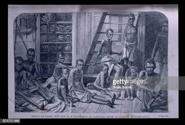 Rescued slaves in the hold of a British war ship after they had been taken from Arab slave traders illegally transporting them in dhows The British...