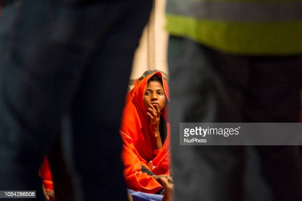 A rescued woman waiting to be attended by the Red cross Malaga