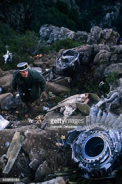 Rescuer climbs toward a pile of wreckage in the mountains near Ajaccio, Corsica. On December 1 a charter Yugoslavian DC-9 crashed in the Corsica...