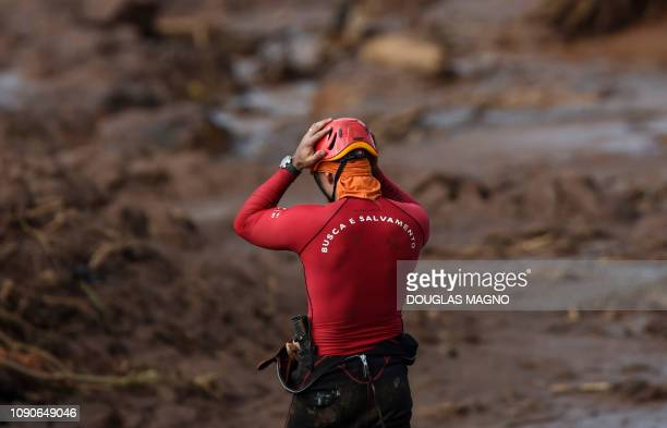A rescuer gestures as he searches for victims of Friday's dam collapse near the town of Brumadinho state of Minas Gerais southeastern Brazil on...
