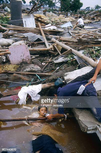 A rescuer helps a child who was caught in a lahar as it flowed from the erupting Nevado del Ruiz volcano in Colombia The 1985 eruption completely...