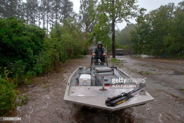 Rescuer John Bridges with the Cajun Navy rides a boat on a trailer after completing a rescue in Lumberton North Carolina on September 15 2018 in the...