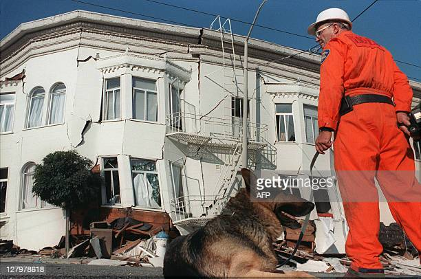 Rescuer looks at a collapsed house, on October 18 in the Marina District of San Francisco, one of the areas hardest hit in the city by an earthquake...