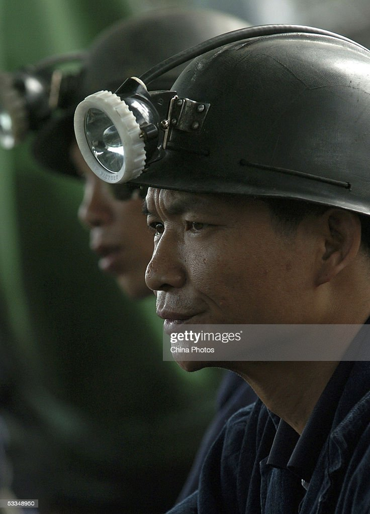 A rescuer rests during a rescue mission at the Daxing Colliery, where a flood trapped over 100 miners, August 10, 2005 in Xingning, Guangdong province, south China. Rescuers today recovered the first body of the trapped miners after the coal mine flooded on August 7, officials said. After verifying information with people coming forward to report missing relatives, Guangdong's Vice Governor You Ningfeng told reporters on August 9 the new number of trapped workers is 123. Many managers of the coal mine fled after the accident, increasing the difficulties for rescue work. The miners' chances of surviving were 'slim' after being trapped more than three days 1,580 feet underground as water continues to gush into the pit, officials said.