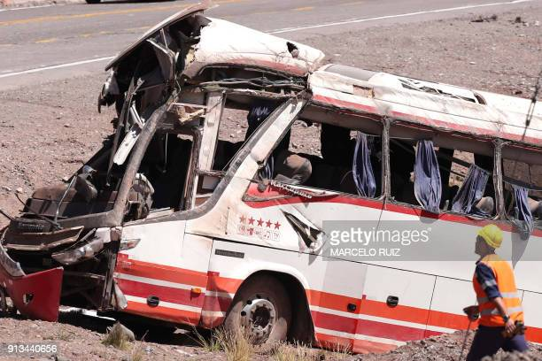 A rescuer works at the scene after a bus carrying teenagers from a Chilean football school crashed into another bus on its way to Paraguay near Las...