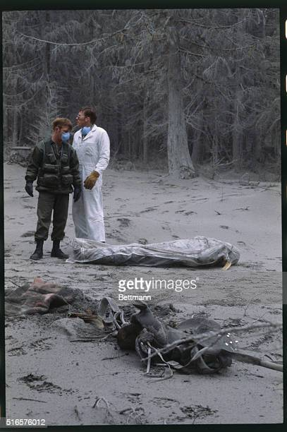 Rescuers about to remove body from campsite near Mount Saint Helens after the volcano erupted May 28 Ash covers the pine trees and ground like snow