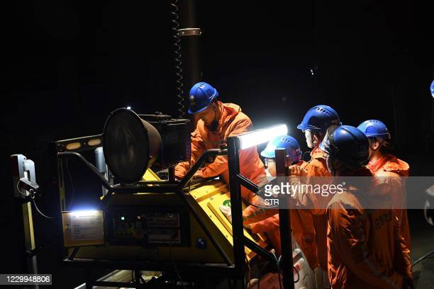 Rescuers adjust an emergency generator at the Diaoshuidong coal mine in southwestern China's Chongqing on December 5 after a carbon monoxide leak at...
