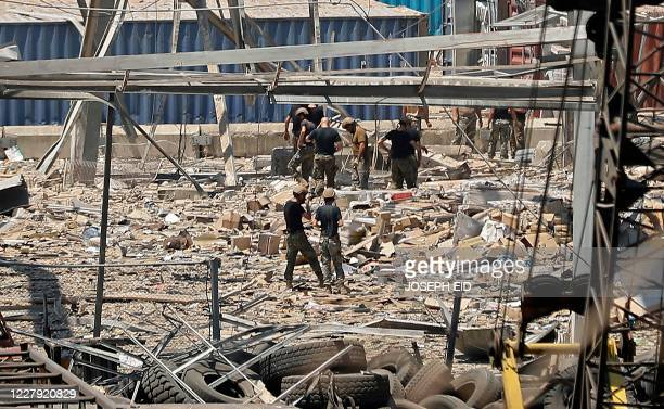Rescuers and civil defence search through the debris at Beirut ports silo on August 5 2020 in the aftermath of a massive explosion in the Lebanese...