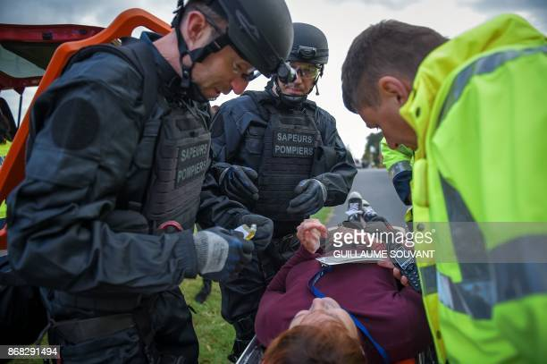 Rescuers and Firefighters take care of a victim during an exercise simulating a terrorist attack inside the theatre Espace Malraux in JouelesTours...