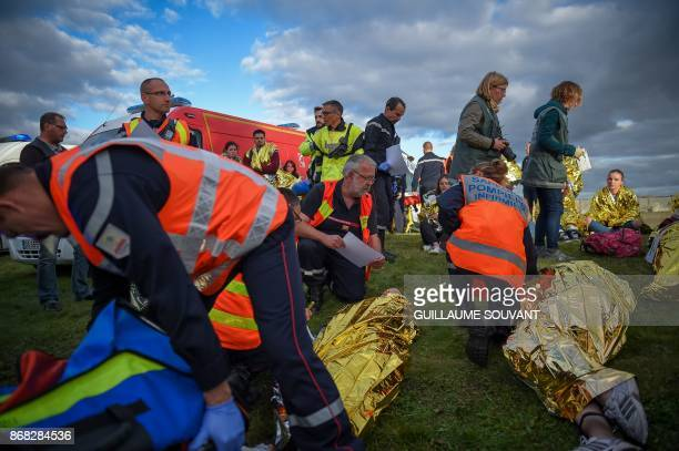 Rescuers and Firefighters take care of the victims during an exercise simulating a terrorist attack inside the theatre Espace Malraux in JouelesTours...