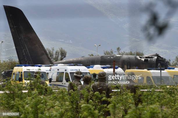 Rescuers and security forces are seen around the wreckage of an Algerian army plane which crashed near the Boufarik airbase from where the plane had...