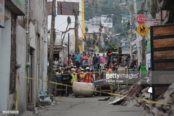 Rescuers and volunteers search for survivors amid the rubble at San Gregorio Atlapulco a day after the magnitude 71 earthquake jolted central Mexico...