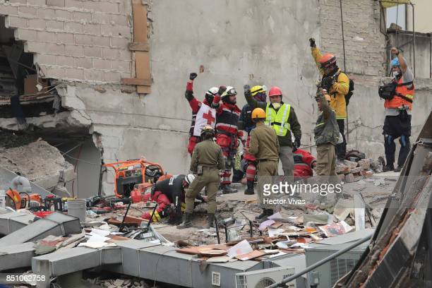 Rescuers and volunteers work in a building that collapsed two days after the magnitude 71 earthquake jolted central Mexico killing more than 250...