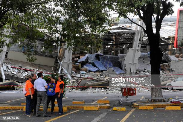 Rescuers and volunteers work in a collapsed supermarket at Taxqueña two days after the magnitude 71 earthquake jolted central Mexico killing more...