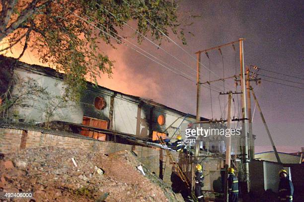 Rescuers are seen at the site of an explosion at a warehouse in Beichen district in Tianjin on October 13 2015 A warehouse explosion hit the Chinese...