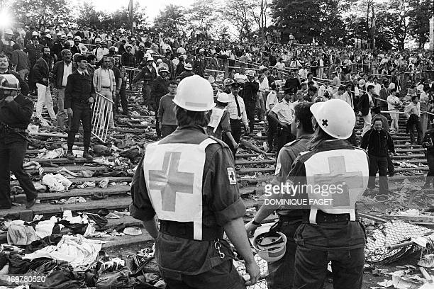 Rescuers attend 29 May 1985 victims at the scene of riots in Heysel football stadium in Brussels after thirtynine Juventus football fans died during...