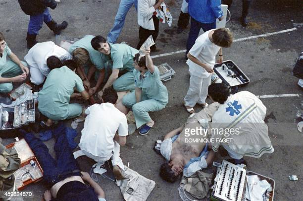 Rescuers attend victims on May 29 1985 after 39 people lost their lives and more than 600 others were injured in violent incidents inside the stadium...