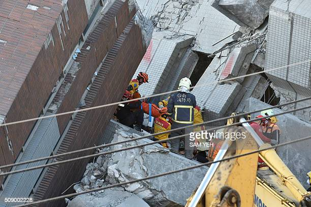 Rescuers bring an eightyear old girl survivor to waiting personnel after she was rescued from the rubble at the WeiKuan complex which collapsed in...