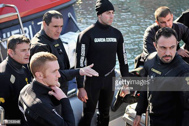 Rescuers Carabinieri of GIS work on the cruise ship Costa Concordia as it lies stricken off the shore of the island of Giglio on January 17 2012 in...