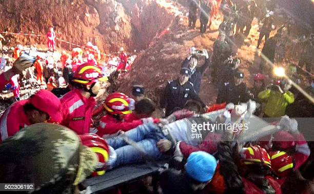 TOPSHOT Rescuers carry 19yearold survivor Tian Zeming after he was pulled from debris on December 23 2015 some 67 hours after a giant flow of mud and...