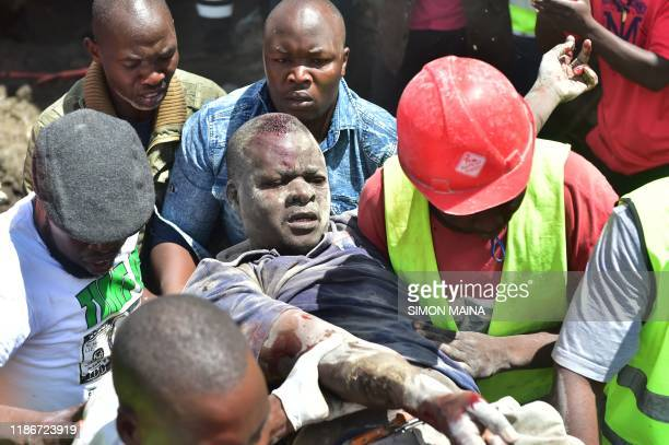 Rescuers carry an injured man out of the scene where a sixstorey building collapsed in Nairobi on December 6 2019