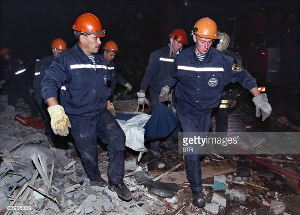 Rescuers carry the body of a victim after an explosion destroyed four storeys out of 18 of an apartment block in Pechatniki suburb southeast of...