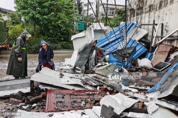 Rescuers clean up debris after a 5.4 earthquake that killed three and injured a dozen in Luzhou, in China's southwestern Sichuan province on...
