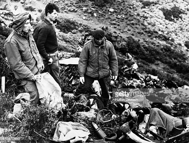Rescuers collecting the bodies of some of the 85 passengers and 5 crew members killed in the Olympic Airways DC 6B airplane crash that occured near...