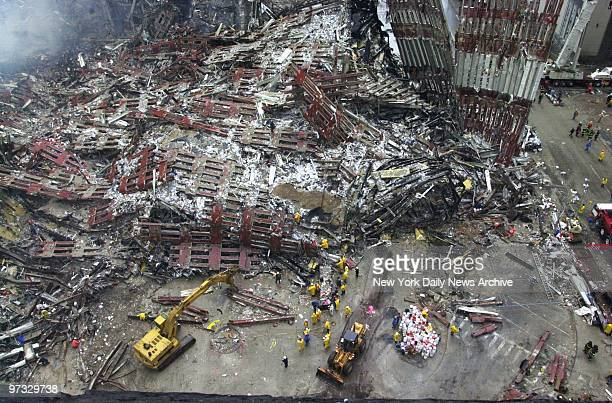 Rescuers continue their search for survivors amid the twisted metal, glass and concrete that was once the twin towers of the World Trade Center,...