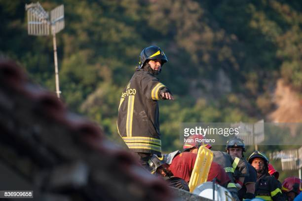 Rescuers dig through the rubble during a search for two missing children on August 22 2017 in Casamicciola Terme Italy A magnitude40 earthquake...