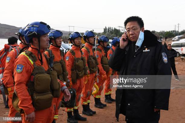 Rescuers discuss the details to search for survivors in Jingtai County of Baiyin City, northwest China's Gansu Province, May 23, 2021.The death toll...