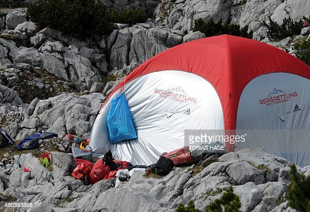 Rescuers' equipment is pictured next to a tent at the Untersberg near Marktschellenberg southern Germany on June 10 2014 near the entrance of the...