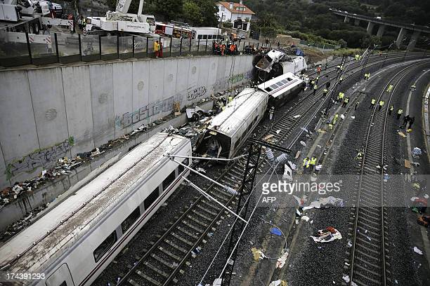 Rescuers forensics and police officers work at the site of a train accident near the city of Santiago de Compostela on July 25 2013 A train hurtled...