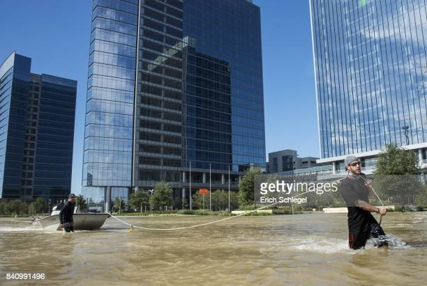 Rescuers from Odessa Texas make their way along Eldridge Parkway in the Energy Corridor of west Houston on August 30 2017 in Houston Texas Harvey...