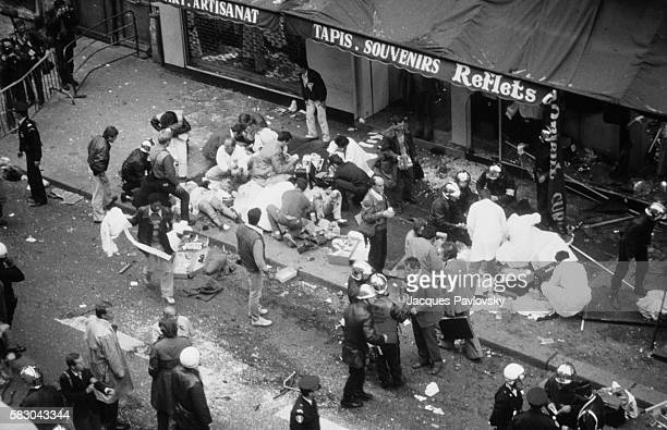 Rescuers gather around the injured following an explosion outside the Tati department store in Paris On September 17 a terrorist's bomb exploded...
