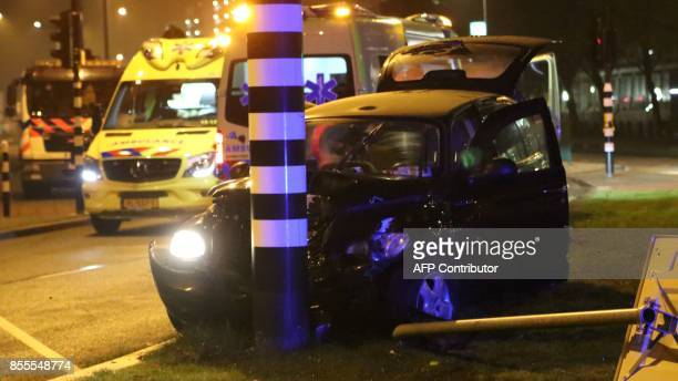 Rescuers gather on the scene of a car accident involving Manchester City's Argentine striker Sergio Aguero on September 28 2017 in Amsterdam Aguero...