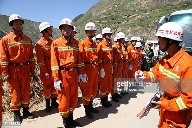 Rescuers head to quakehit areas on July 22 2013 in Minxian China At least 89 people were killed and 5 others missing after a 66magnitude earthquake...