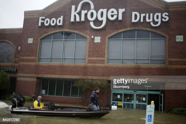 Rescuers in a boat move past a Kroger Co grocery store after Hurricane Harvey in Spring Texas US on Monday Aug 28 2017 A deluge of rain and rising...
