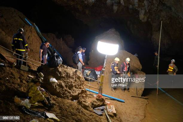 Rescuers install a water pump inside Tham Luang Nang Non cave on June 28 2018 in Chiang Rai Thailand Rescuers battle heavy rain in northern Thailand...