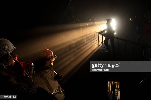 Rescuers join Tazrin garment factory fire rescue operation at Ashuliya on early morning on the outskirts of Bangladesh capital. At least more than...
