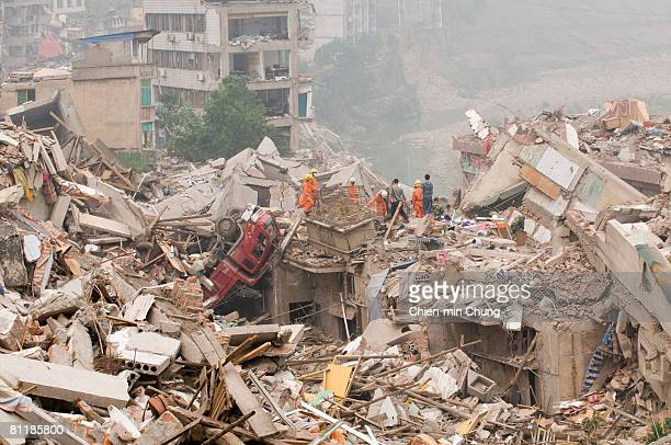Rescuers look for survivors in a collapsed building May 17 2008 in Beichuan China 50000 people are estimated to have been killed in the deadliest...