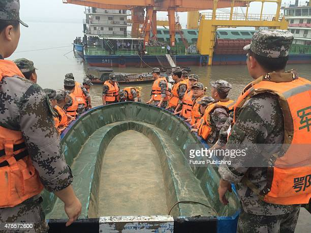 Rescuers move charge boats into the Yangtze River to search for missing passengers from a capsized cruise ship on June 02 2015 in Jianli China 458...