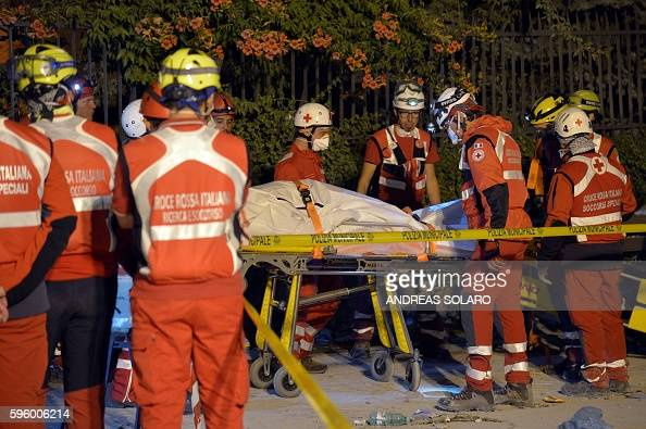 Male On A Stretcher Surrounded By Paramedics Editorial