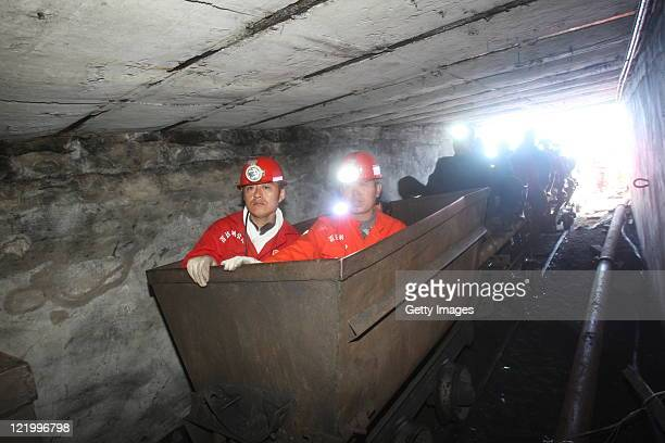 Rescuers prepare to enter a flooded coal pit to rescue trapped workers in Hengtai coal mine on August 24 2011 in Qitaihe Heilongjiang Province of...