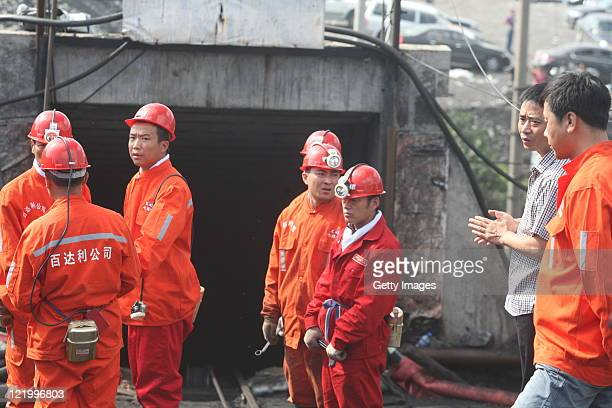 Rescuers prepare to enter a flooded coal pit to rescue trapped workers in Hengtai coal mine on August 24, 2011 in Qitaihe, Heilongjiang Province of...