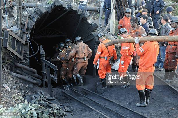 Rescuers prepare to enter the Sizhuang Coal Mine to rescue trapped miners on November 10, 2011 in Shizong County, Yunnan Province of China. 20 people...