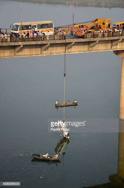 Rescuers pull off the car fell down in to river Ganga from Shastri bridge after meeting an accident in Allahabad