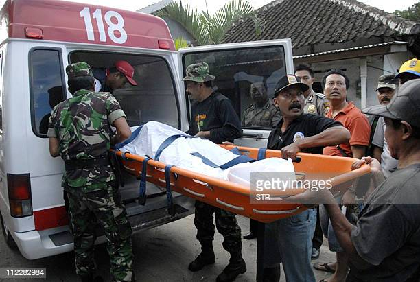 Rescuers recover a body of a landslide victim after nine people were killed and another seven injured in Klangon village in Indonesia's East Java...