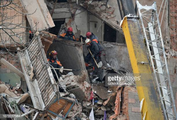 Rescuers remove rubble from a partially destroyed fivestorey building on the site of a gas explosion in the town of Fastiv on December 14 2018 A gas...