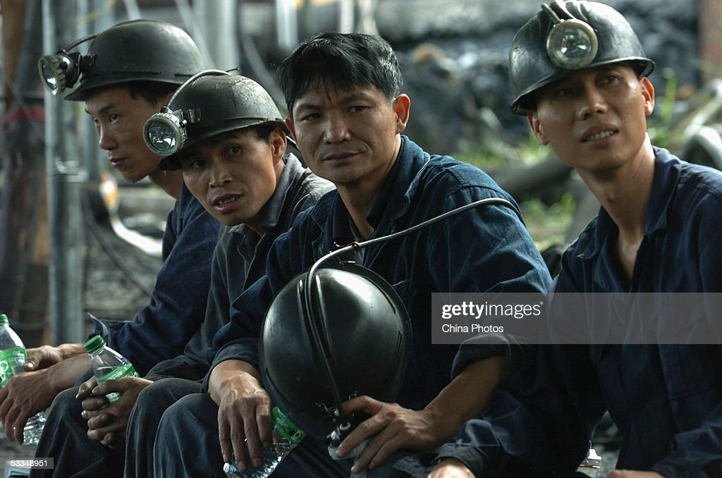 Rescuers rest during a rescue mission at the Daxing Colliery, where a flood trapped over 100 miners, August 10, 2005 in Xingning, Guangdong province, south China. Rescuers today recovered the first body of the trapped miners after the coal mine flooded on August 7, officials said. After verifying information with people coming forward to report missing relatives, Guangdong's Vice Governor You Ningfeng told reporters on August 9 the new number of trapped workers is 123. Many managers of the coal mine fled after the accident, increasing the difficulties for rescue work. The miners' chances of surviving were 'slim' after being trapped more than three days 1,580 feet underground as water continues to gush into the pit, officials said.